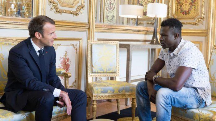 Mamoudou Gassama with President Macron at the Élysée Palace after his heroic climb up a block of flats THIBAULT CAMUS/AP